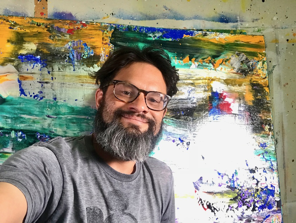 Nestor Toro Self-portrait in his West Hollywood studio with newly finished abstract painting artwork