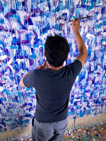 Artist Nestor Toro working on the painting