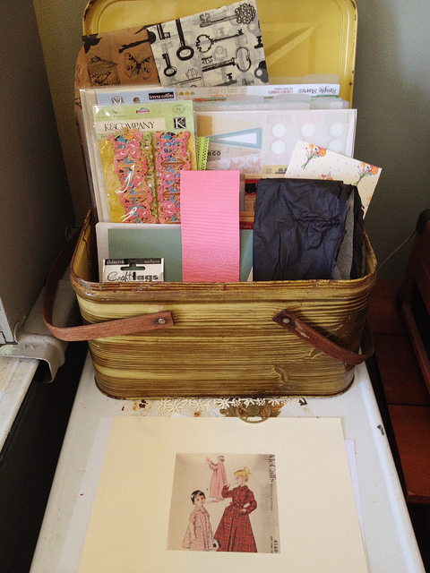 Using a picnic basket to organize and store paper