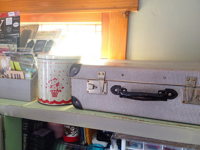 Vintage kitchen tins and suitcases for craft storage