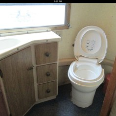 Bathroom, water flush toilet -- Original listing photo from previous owner