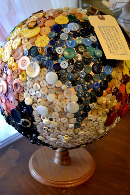 Button-covered globe