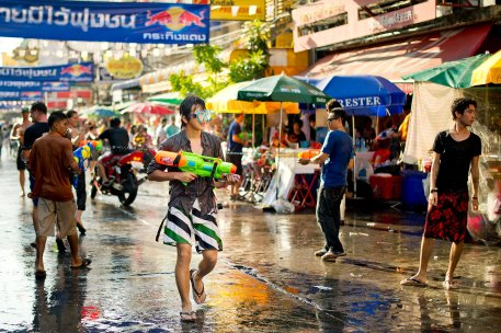 A man pump his water gun during the Songkran festival at Khao San road, a popular tourist area in Bangkok. Songkran is the traditional Thai New Year festival. The most obvious celebration of Songkran is the throwing of water. Buy prints and licenses at http://netphoto.photoshelter.com/gallery/Songkran-Festival-2010/G00002uJGwQcNv0w/C0000h_0jFlaIJUk