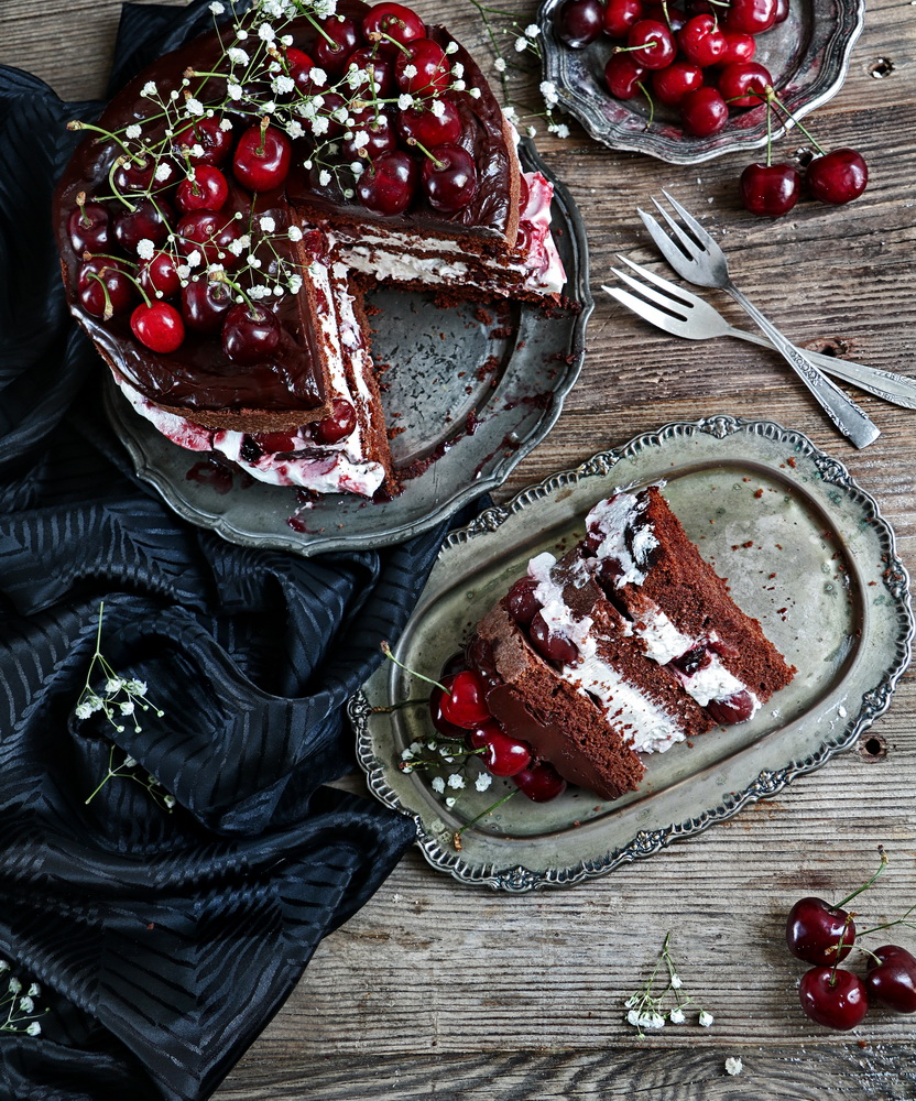 Three Layered Chocolate Cake with Vanilla Wipped Cream and Cherries