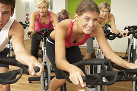 indoor cycling class follows instructor with indoor cycling certification