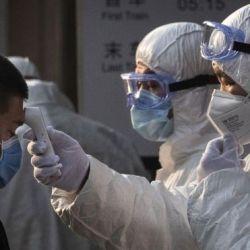 China locks down 400,000 people after virus spike near Beijing