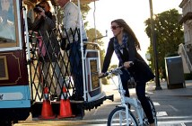 woman riding bicycle with jacket - tern bicycle