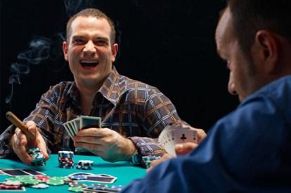 guys-playing-poker-cigars