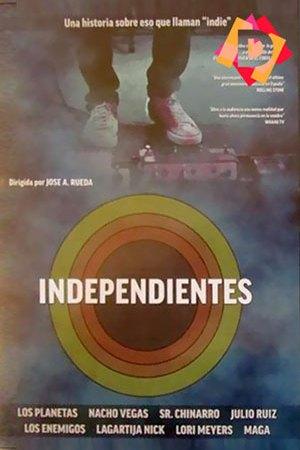 Independientes - 20 Años De Música Indie En España -Piernas y pedales de guitarra electrica sobre escenario con humo