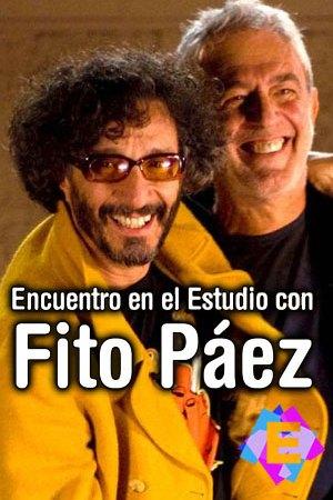 Fito Páez chaqueta amarilla y Lalo Mir chaqueta negra abrazados y sonriendo