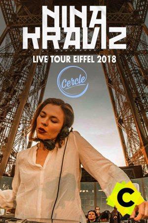 Nina Kraviz - Live Tour Eiffel, Paris 2018. nina kraviz con una blusa blanca