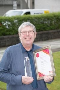 Paul collecting his award