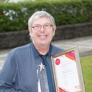Paul collecting his award