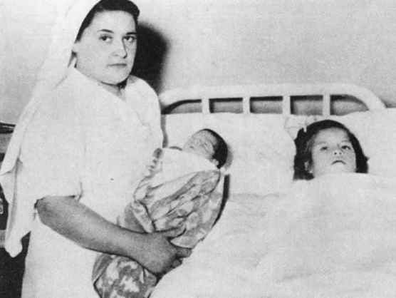 Lina Medina with her midwife after the childbirth