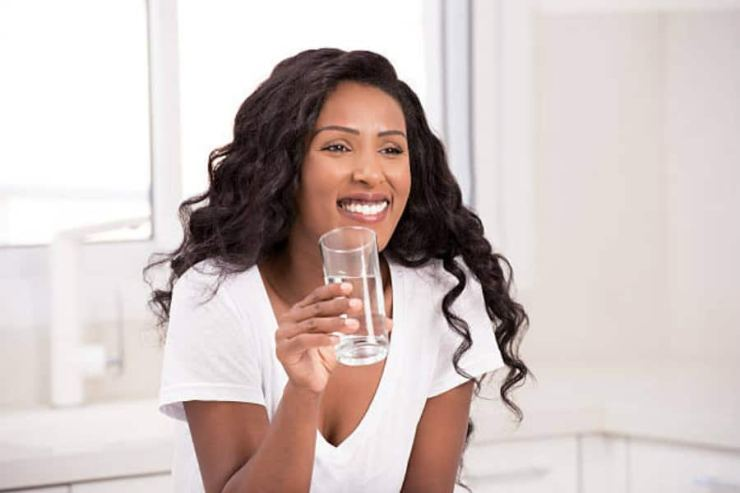 Image result for A Nigerian drinking water after eating See what happens when you drink water immediately after eating See what happens when you drink water immediately after eating e02e2b177c264a9e
