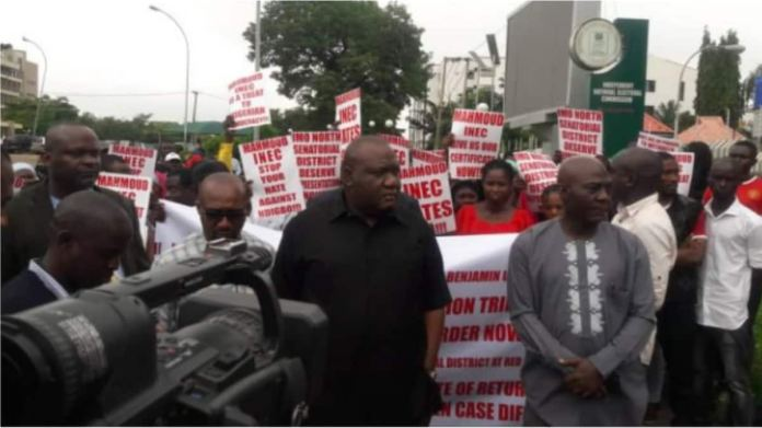 Image result for Elections 2019: Senator-elect leads protesters to INEC headquarters over certificate of return