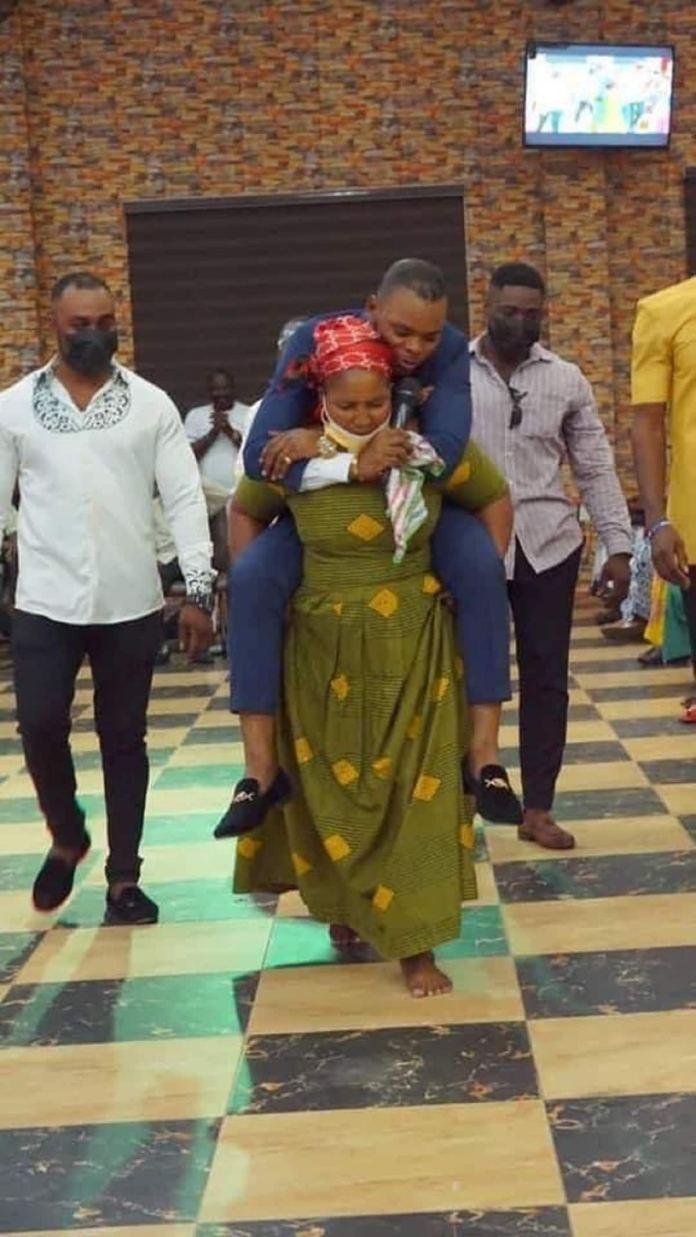 Woman carries Obinim at the back during deliverance from waist pain (photos)