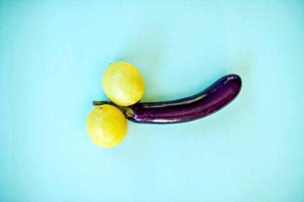 yellow lemon fruit beside yellow round fruit
