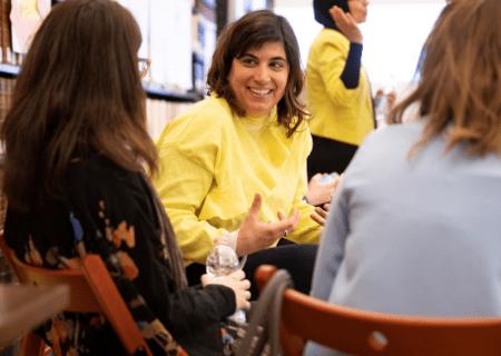 women talking - women sitting - woman smiling