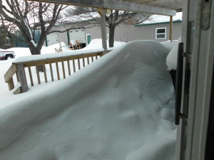 Snowdrift on our back deck.  It goes up & over the railing.  This is from 2 days of snow.  3/20/13