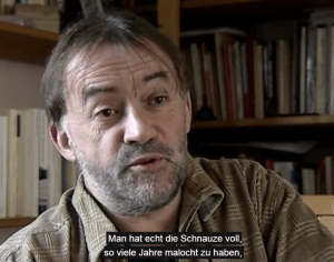 """Jean-Pierre Levaray ist Arbeiter und Autor von """"Verdammte Fabrik"""". (Screenshot/Quelle: Labournet.tv)"""