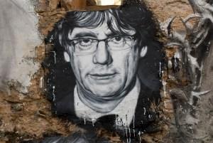 Porträt von Kataloniens Präsidenten Carles Puigdemont an einer Hauswand. (Foto: Thierry Ehrmann;flickr.com; CC BY 2.0)