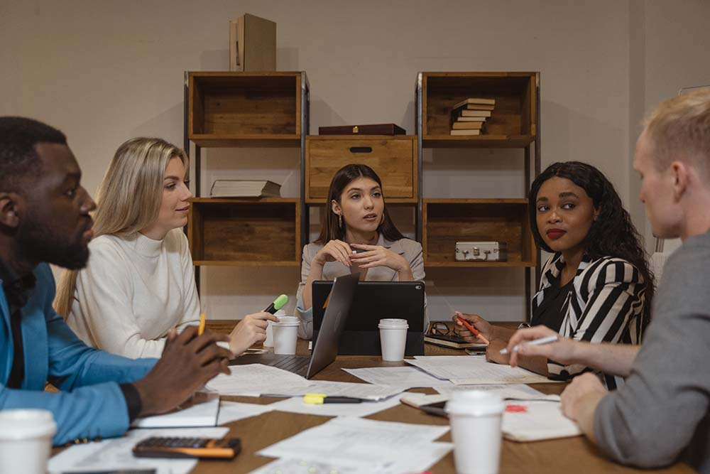 People sitting at a table discussing inclusion