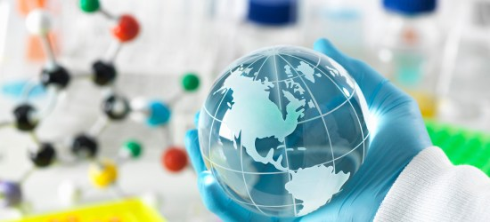 Global research, conceptual image. Scientist holding a globe with a laboratory bench and glassware in the background. image is to demonstrate a community organizer helping the community and autistic people with autism how to navigate the covid-19 corona virus