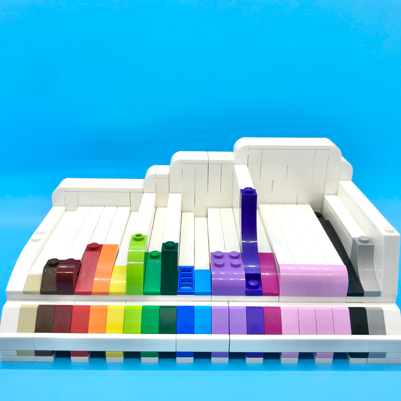 A LEGO slope display, with different slope elements and in a pleasing color order. Front view.