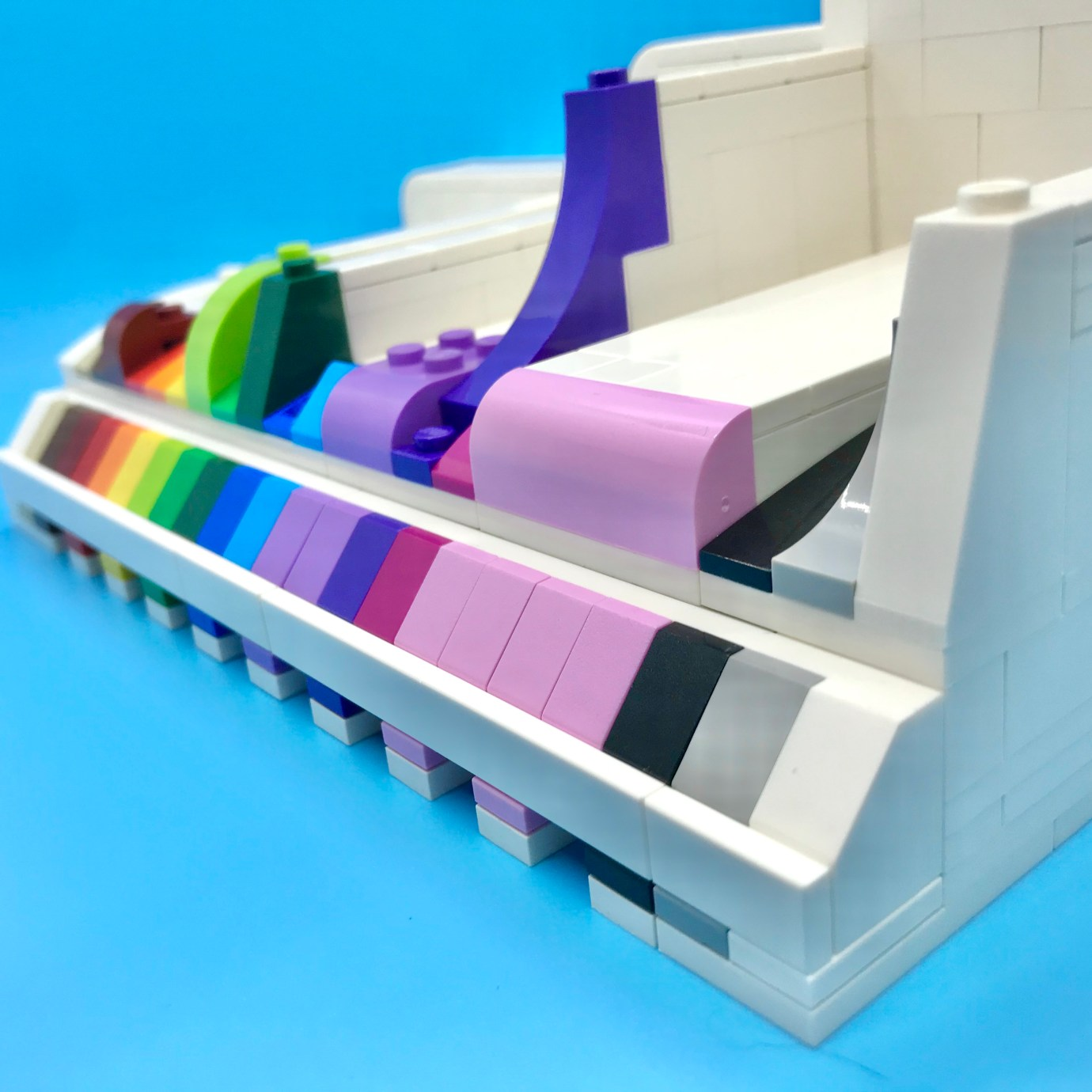 A LEGO slope display, with different slope elements and in a pleasing color order. Angled view.