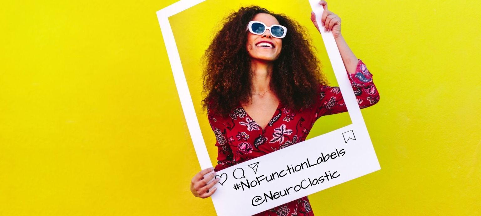 Woman stands in social media frame with #NoFunctionLabels to say that if someone can use the internet they are not high functioning because functioning labels are a myth when it comes to autism and autistic people