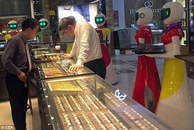Chinese tycoon takes eight robots with him to jewellery shop so they can carry his bags