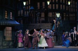 The image shows opera singers performing a scene from La Boheme .