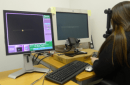 The image shows a participant undergoing an eye tracking experiment.