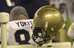 The image shows a football helmet designed to minimize concussion risks.