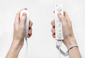 The image shows a person using a Wii game controller.