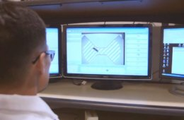 The image shows a person looking at the computer screen with the projection for the maze on it.