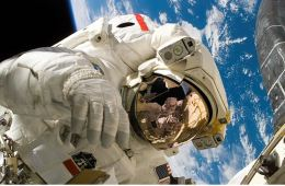 The image shows an astronaut on a space walk.
