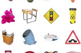 This image shows different items, such as a stuffed toy, desk and traffic sign.
