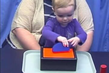 This image is a screen shot from the video and shows a little girl playing the probability game.