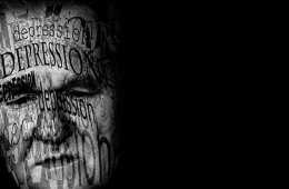 This image shows a black and white picture of a man's face. The word depression is written on it.