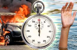 This image shows a burning car, a stop clock and an arm coming out of water.