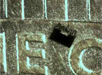 This image shows the microbot on a penny.