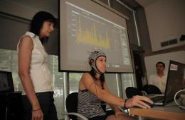 This image shows a woman wearing the EEG.