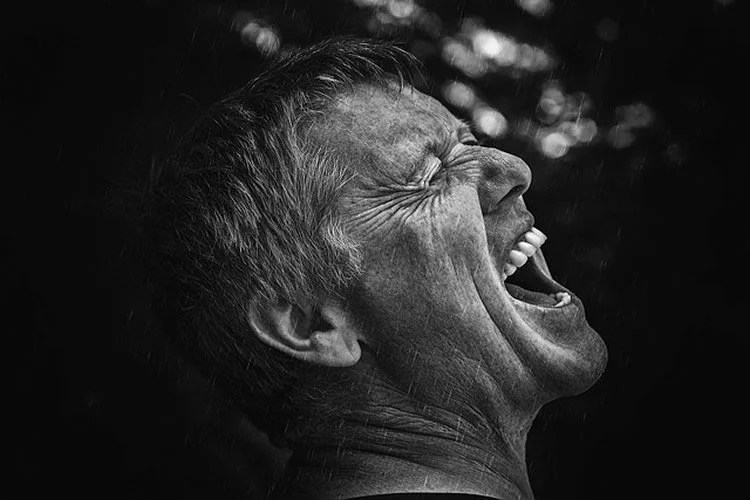 This image shows a man screaming.