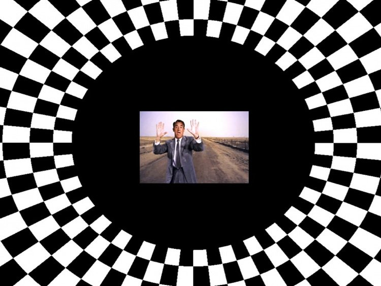 This image shows a clip from a movie surrounded by a checker board design.