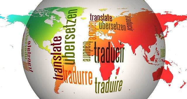 "This image shows a globe with the word ""translate"" writtn in different languages."