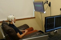 Photo of a participant in the brain to brain communication experiment in an eeg cap.