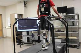 Image shows a person with a prosthetic leg on a treadmill.