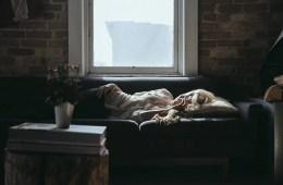 Image of a woman sleeping on a sofa.